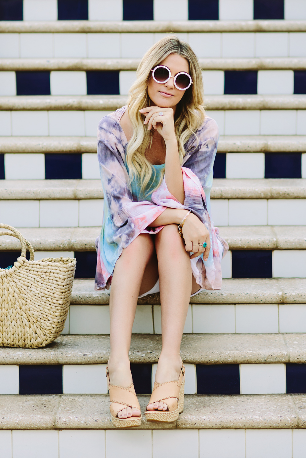 Dash of Darling styles a Tiare Hawaii tie dye tunic with Current Elliott white denim shorts and a woven basket tote for the perfect summer vacation outfit.