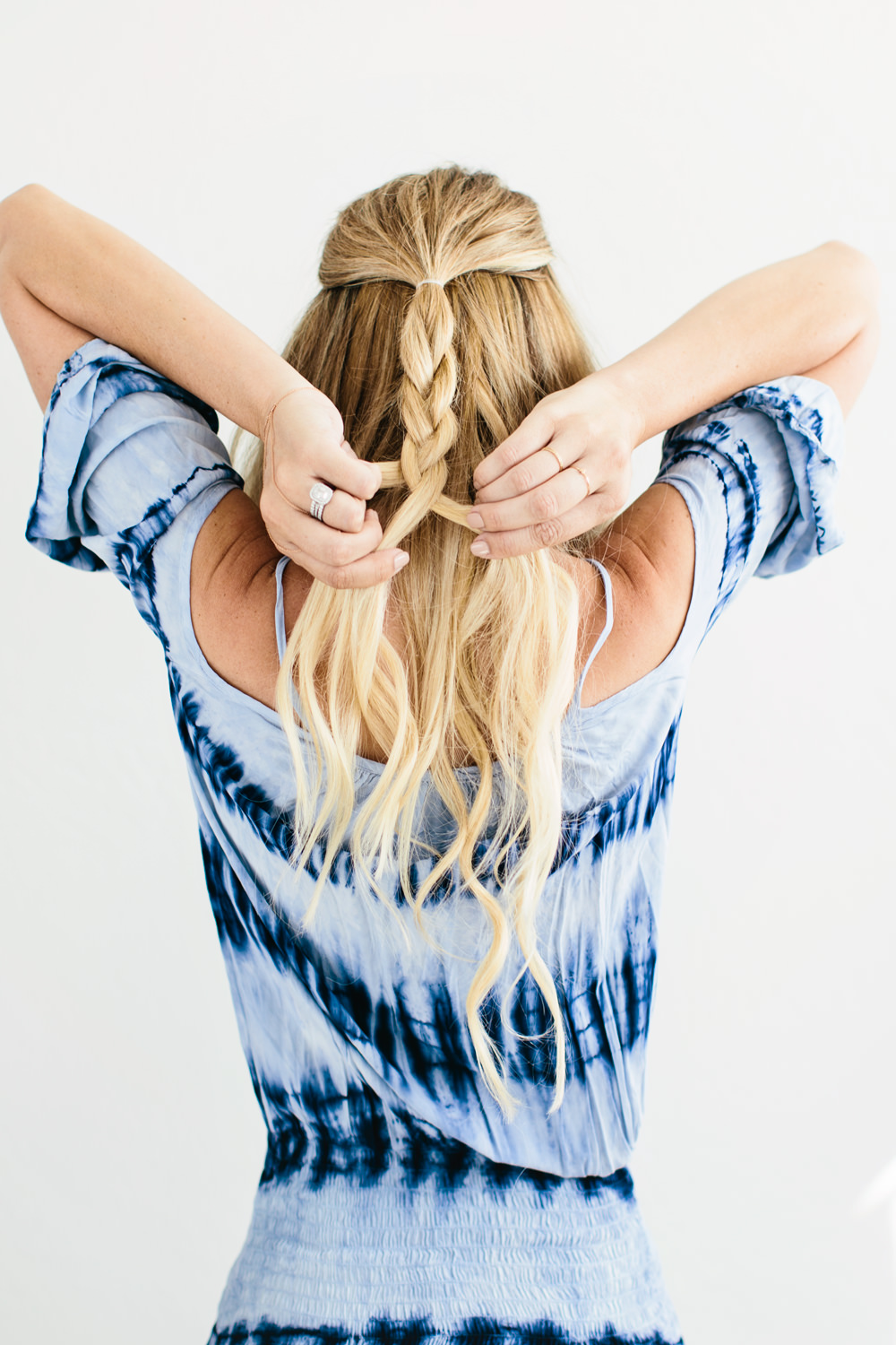 Dash of Darling shares an easy hair tutorial for a romantic mermaid twisted braid tutorial.