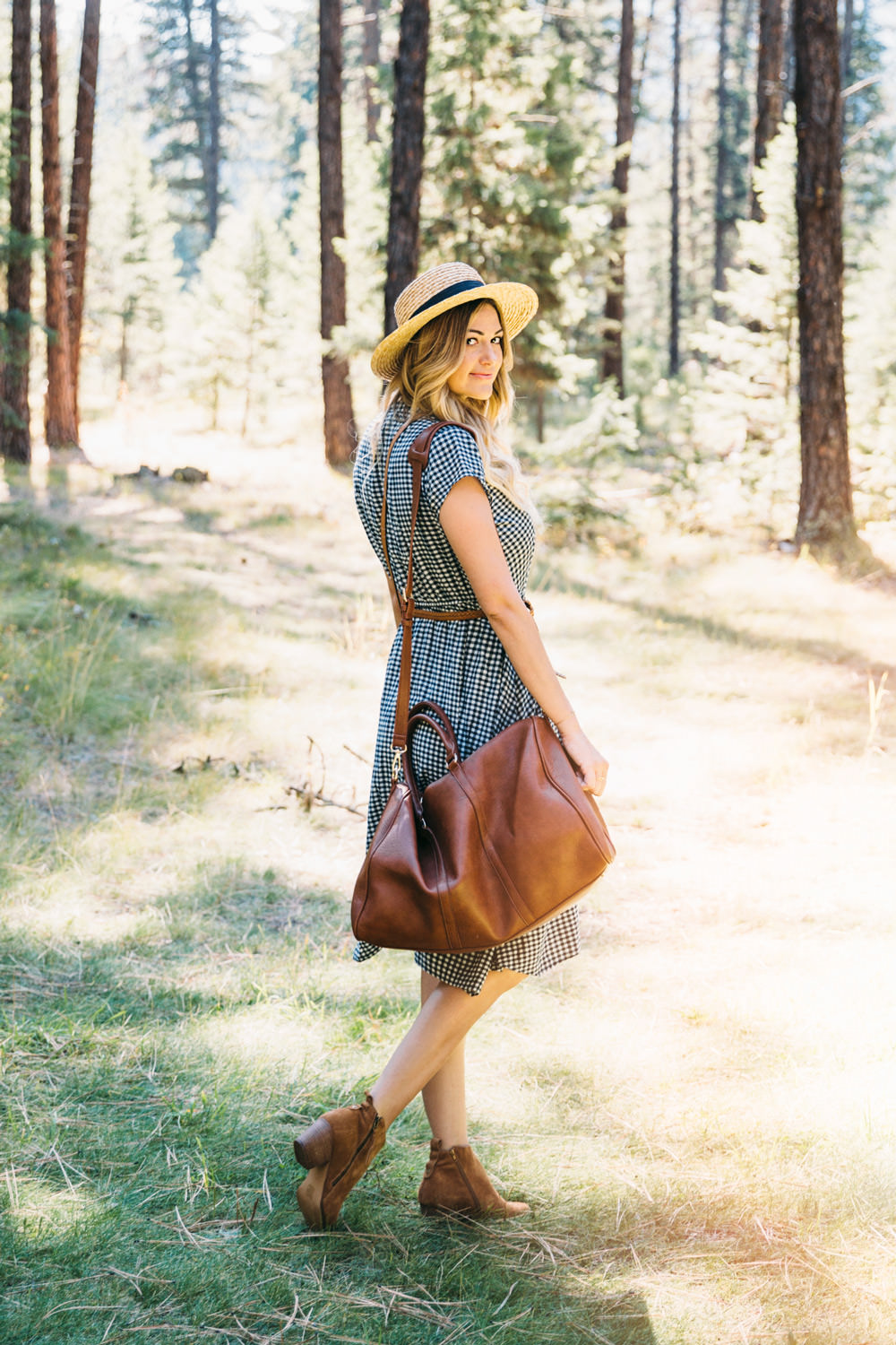 Dash of Darling styles a J.Crew gingham dress with a Sole Society duffle bag, cross body tote and booties for a Fall outfit while traveling to Missoula Montana.