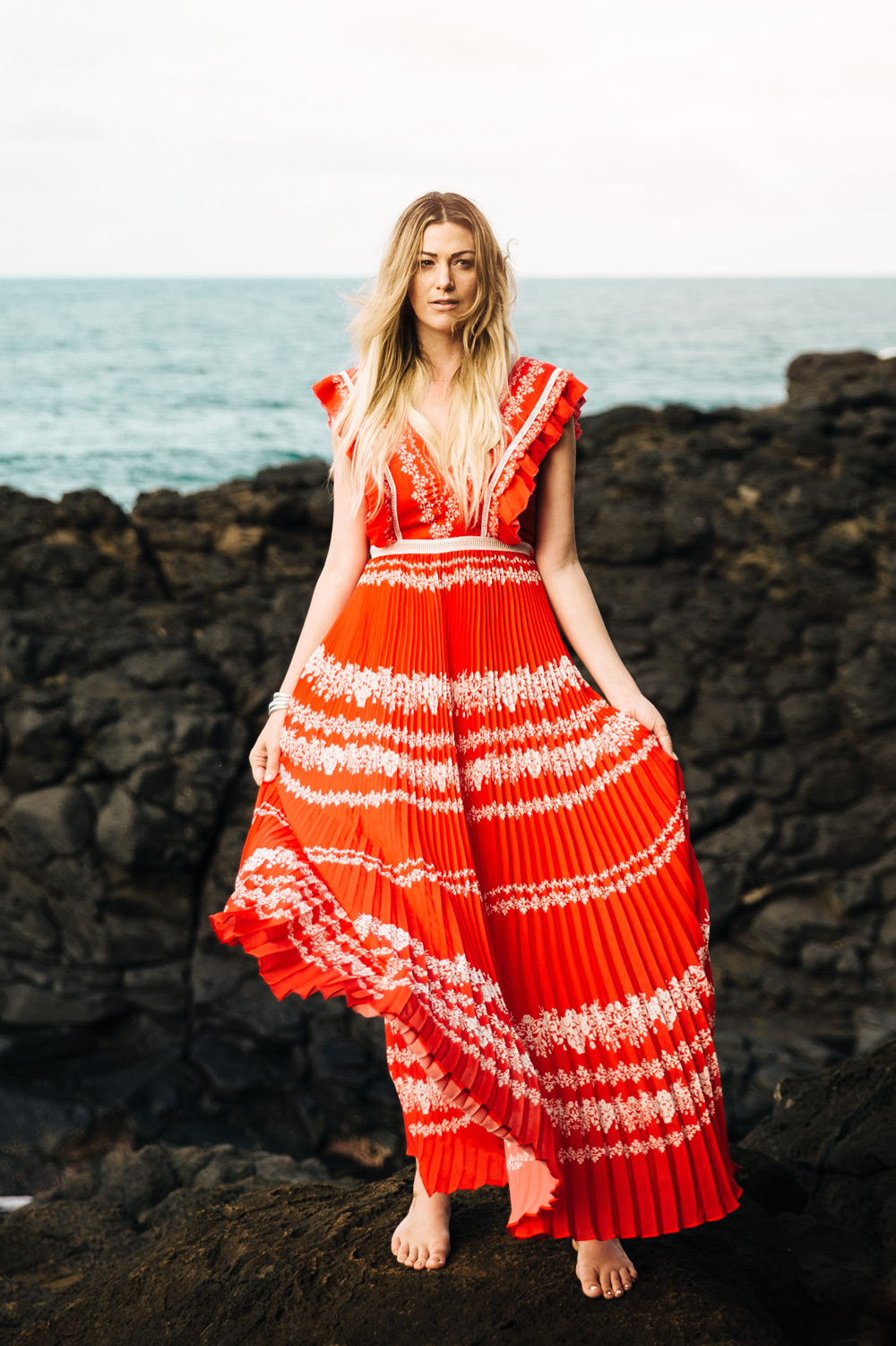Dash of Darling wears a red Self Portrait maxi dress at Queens bath in Kauai, Hawaii while staying at the St. Regis Princeville Resort.