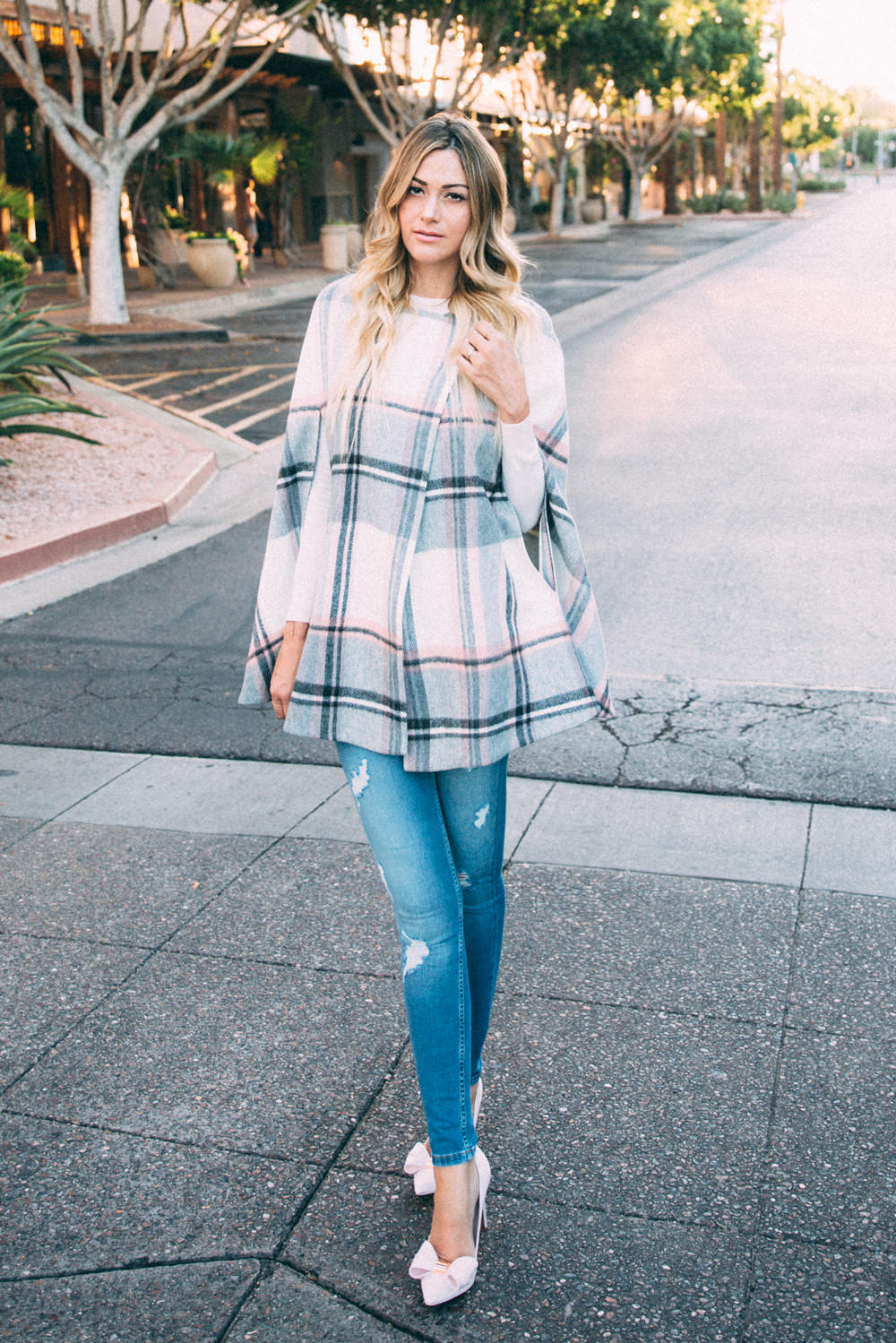 Dash of Darling styles a blush pink plaid cape by Ted Baker with denim jeans and bow heels for a Fall outfit.