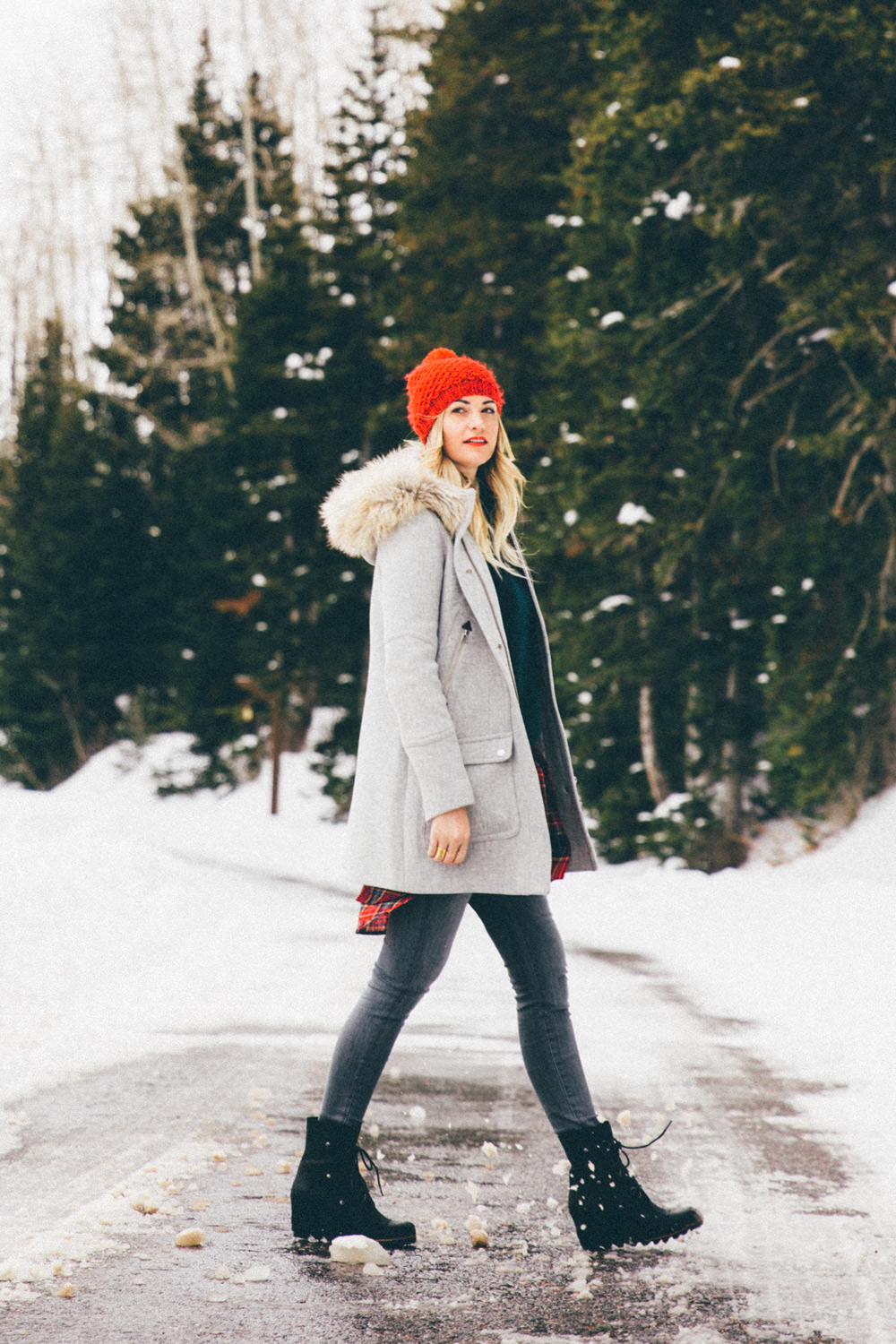 Dash of Darling wears a winter outfit in the snow while visiting home in Park City, Utah