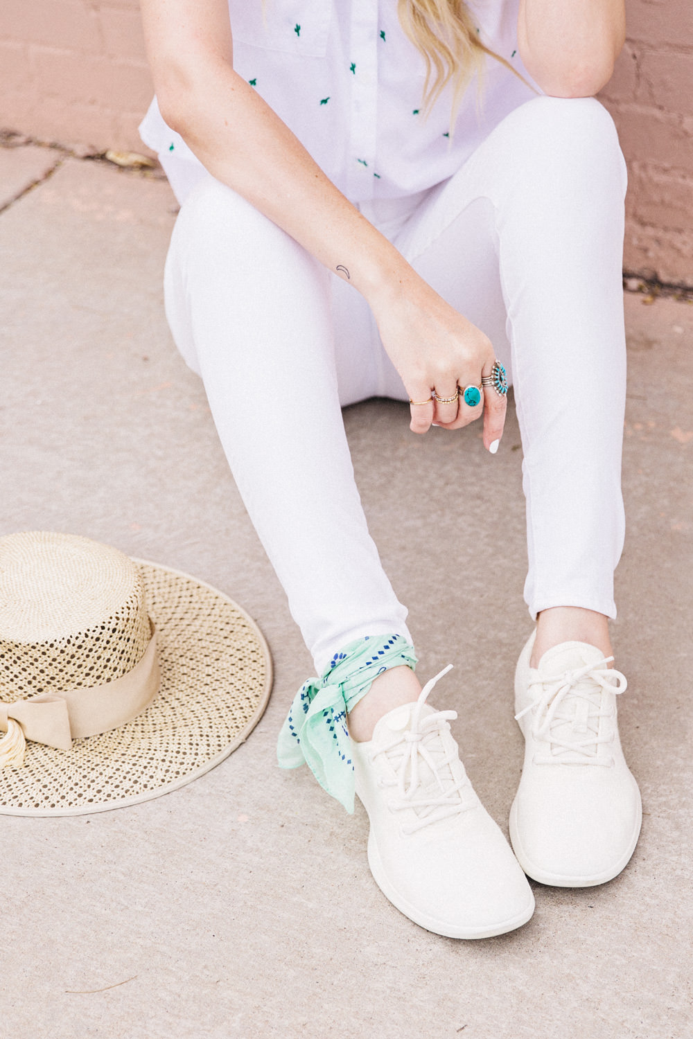 Caitlin Lindquist of Dash of Darling shares an all white outfit for Spring with AllBirds wool runners, white madewell denim, a cactus shirt and a boater hat.