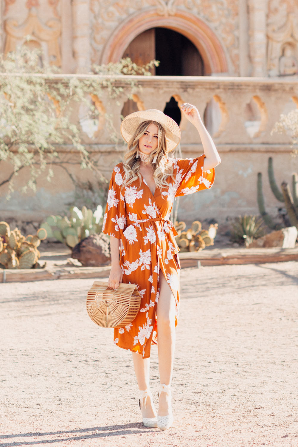 Caitlin Lindquist of the Arizona fashion blog Dash of Darling shares a summer outfit in an orange rust Rue Stiic kimono wrap dress and Preston and Olivia hat.