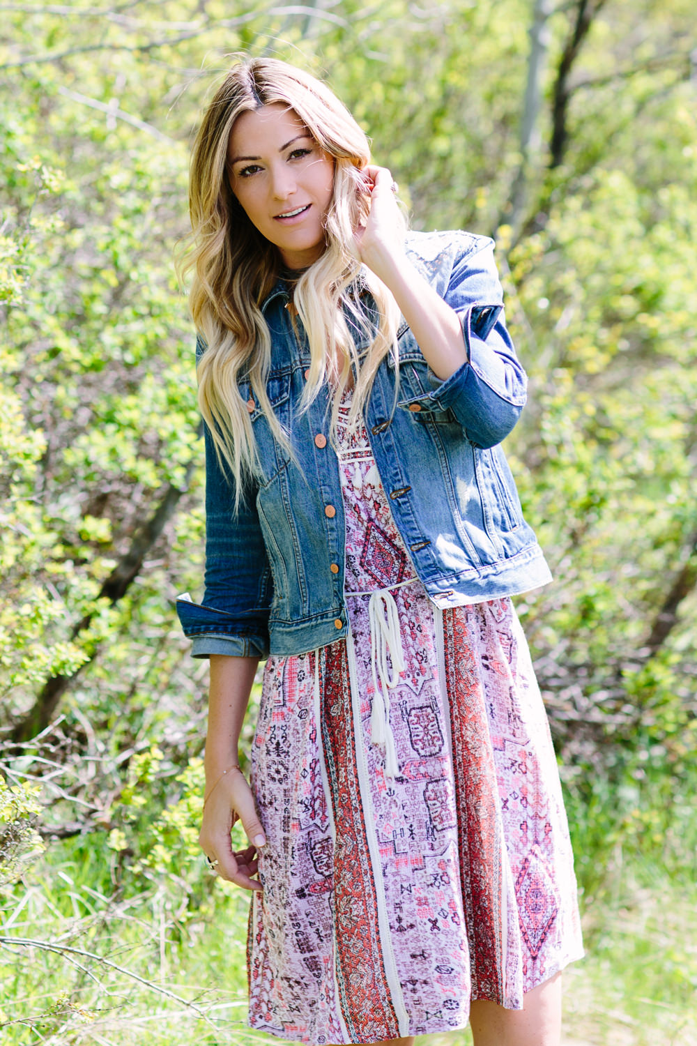 Dash of Darling styles a Lucky printed cotton dress with a denim jacket for summer.