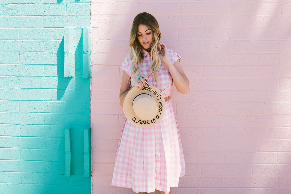 Dash of Darling wears an Eliza J gingham pink checkered poplin dress with a straw boater for summer in Arizona.