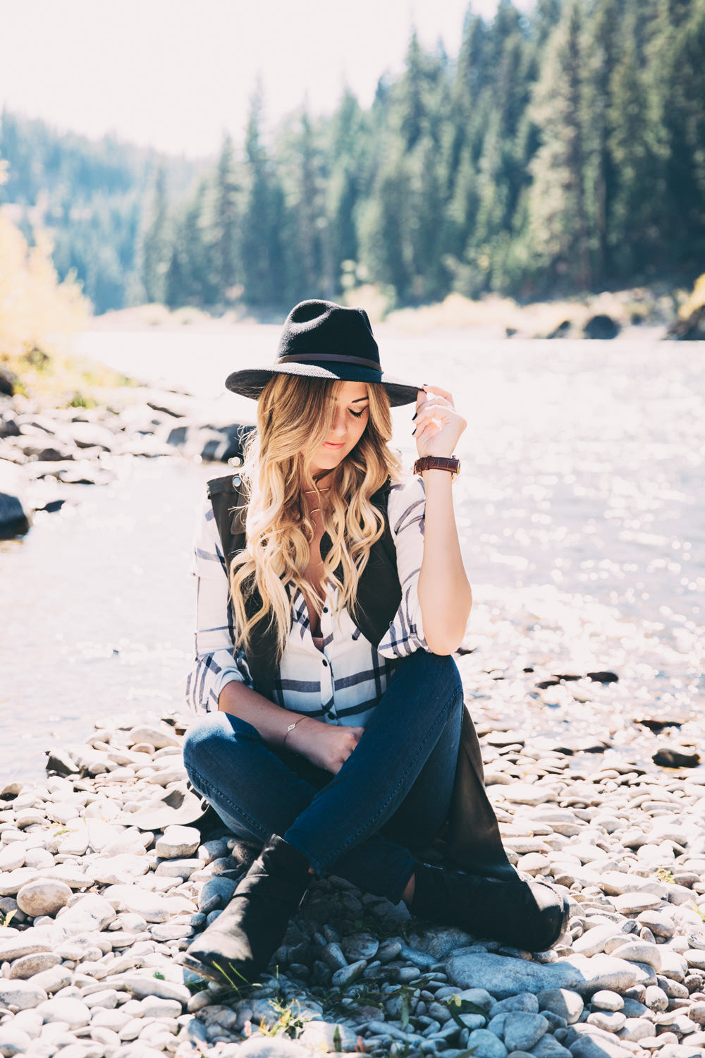 Dash of Darling wears a plaid blouse with an olive Anthropologie vest, Madewell jeans and Born booties from Nordstrom for fall while traveling in Montana.