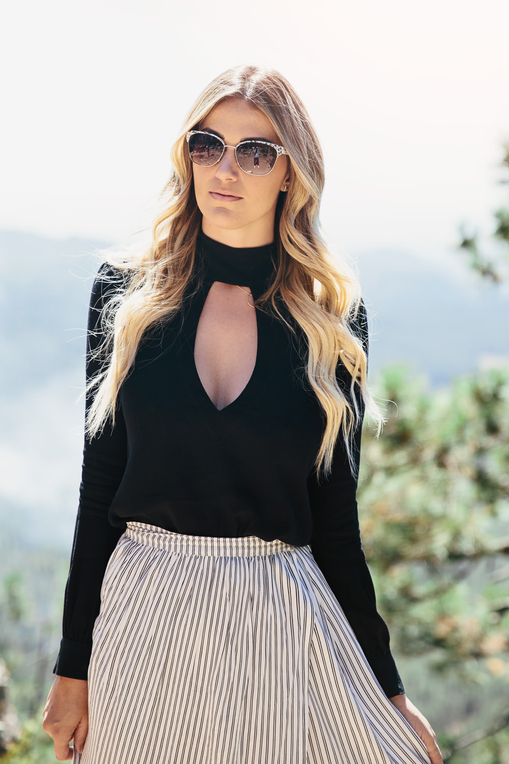 Dash of Darling styles a keyhole neckline top with a maxi skirt and DVF sunglasses while exploring Payson Arizona in the Fall.