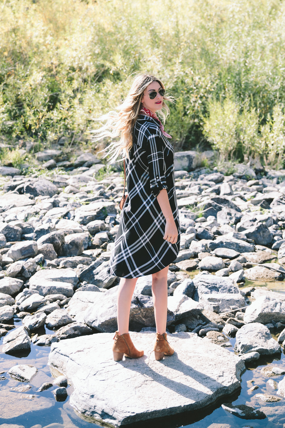 Dash of Darling styles three Fall trends with Stein Mart, from plaid to olive green to high-low hems while traveling in Montana.