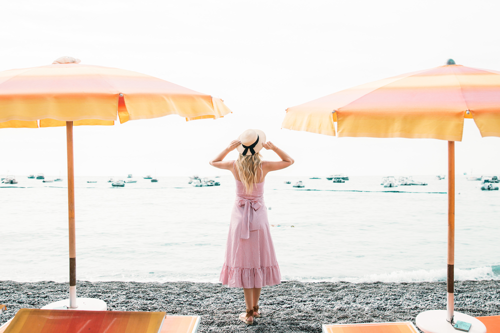 Caitlin Lindquist of Dash of Darling shares her travel diary from Positano, Italy with Royal Caribbean Cruises while wearing a stripe Elle Sasson dress.
