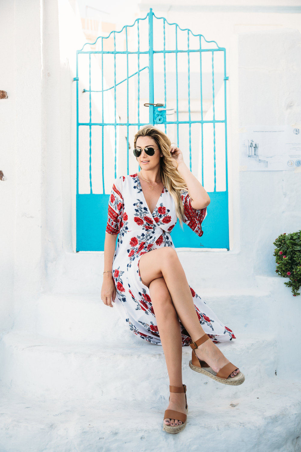 Dash of Darling shares her travels to Santorini, Greece with Royal Caribbean Cruises while wearing a Reverse dress from Revolve Clothing.