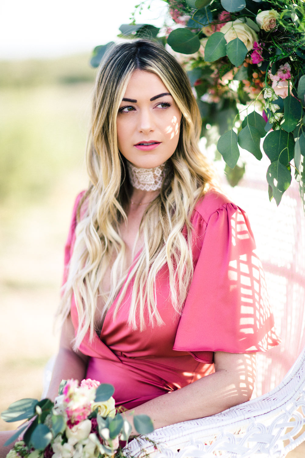 Caitlin Lindquist of Dash of Darling shares a Valentine's Day styled shoot in Scottsdale, Arizona wearing a silk Privacy Please wrap dress and Vanessa Mooney lace choker.