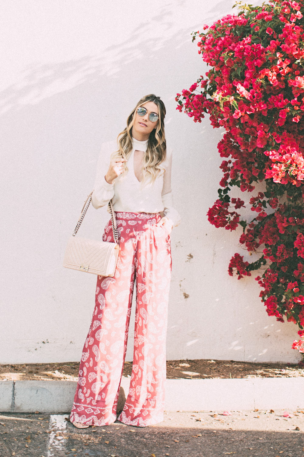 Caitlin Lindquist of the Arizona fashion blog Dash of Darling shares how to style pink high waisted paisley pants for spring