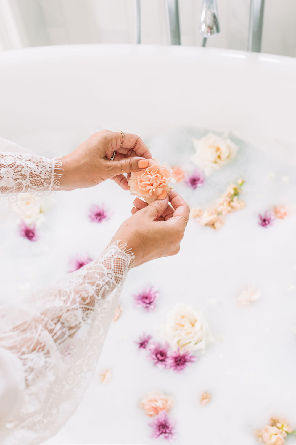 Caitlin Lindquist of the Arizona beauty blog Dash of Darling shares three steps to smooth summer skin while taking a relaxing bath with petals.